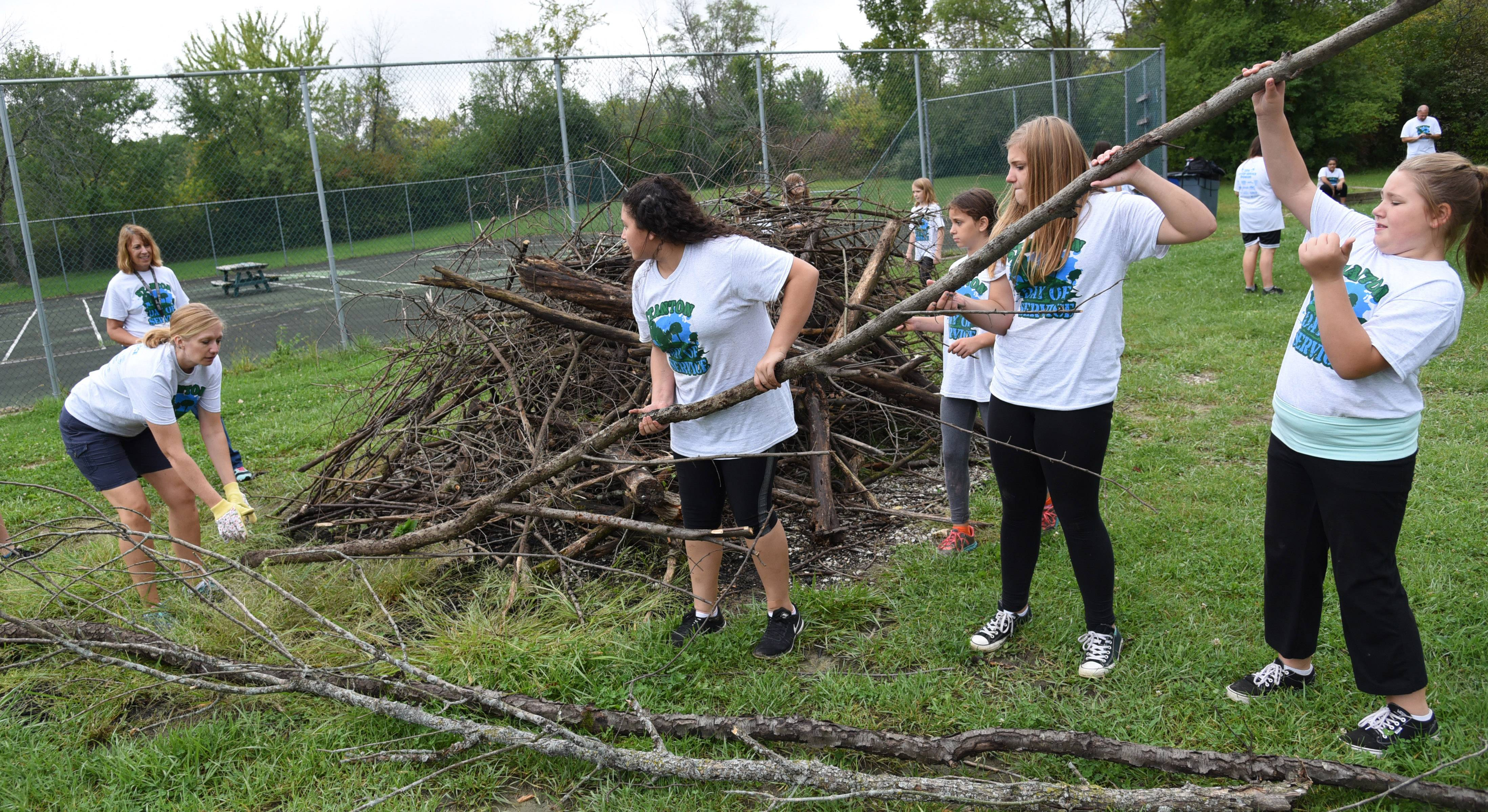 Nineteen students and three teachers from Stanton School in Fox Lake cleared hiking paths of sticks and debris Friday at Camp Henry Horner in Ingleside as part of the school's annual Day of Service project in the community.
