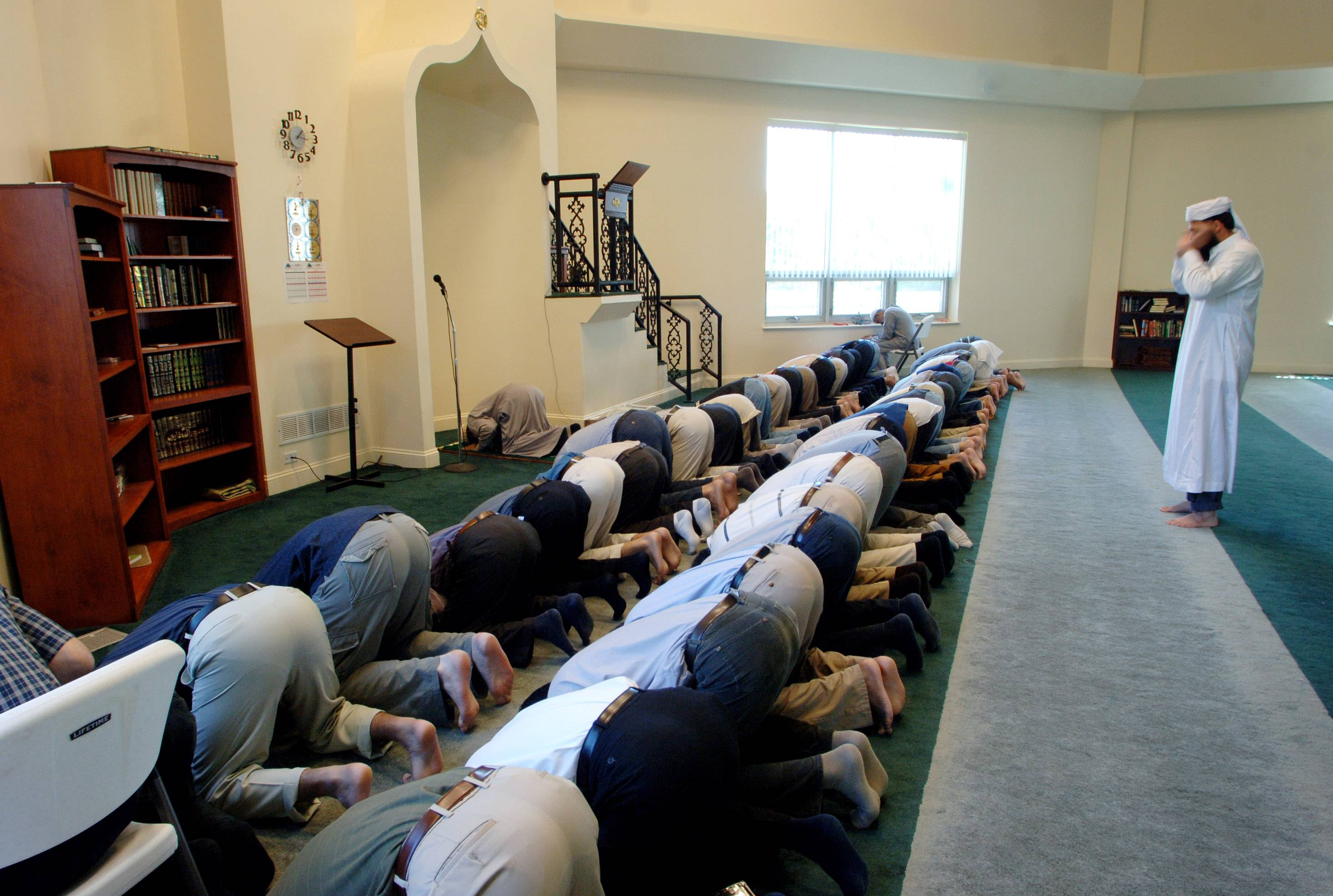 Men participate in prayer at the Islamic Foundation North mosque near Libertyville for the Islamic religious observance of Ramadan.