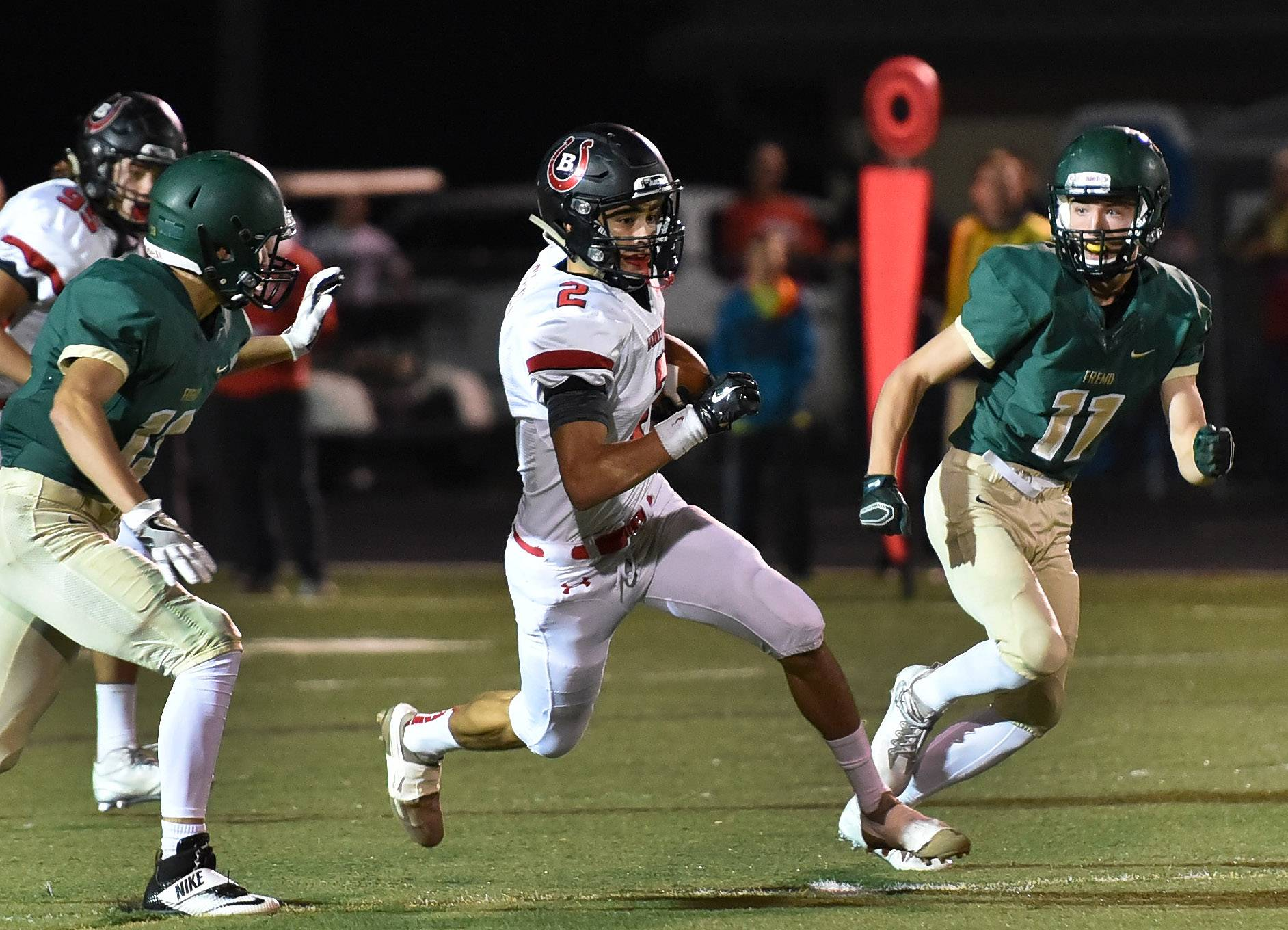 Barrington's Luis Cossio eludes Fremd tacklers.