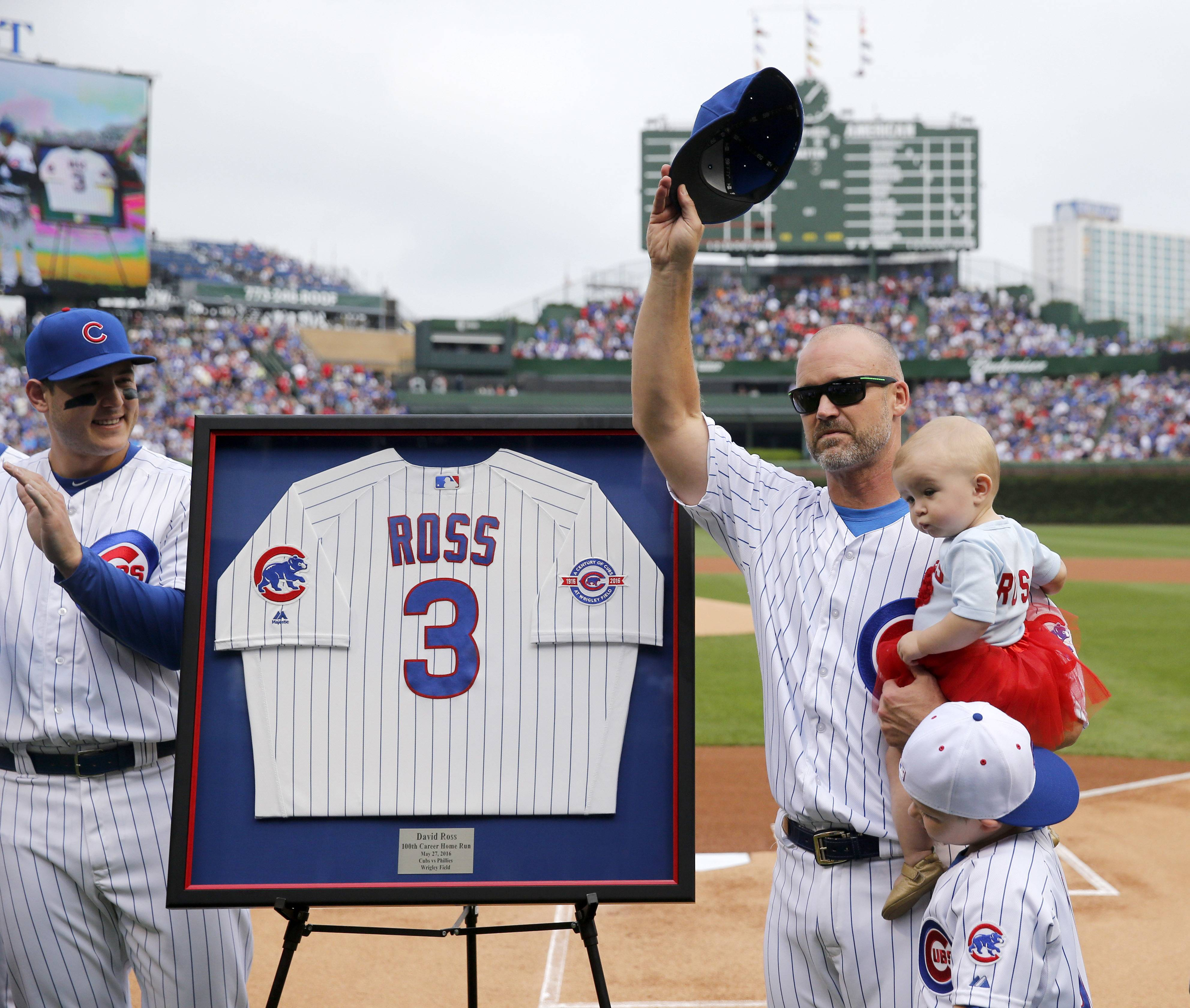 Chicago Cubs' David Ross, right, acknowledges the crowd as he is honored before Friday's game between the Cubs and the St. Louis Cardinals in Chicago. Ross had announced earlier in the season this would be his last.