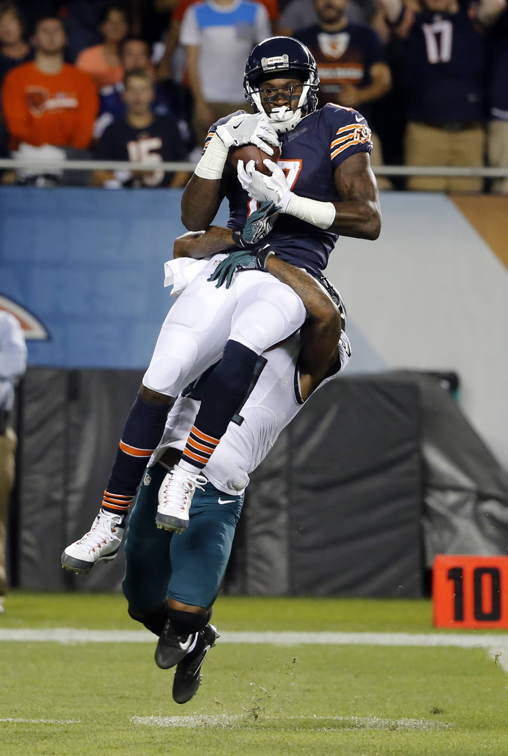 Bears wide receiver Alshon Jeffery makes a catch against Philadelphia Eagles free safety Jalen Mills during the first half on Monday in Chicago.