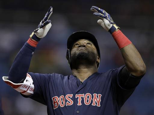 Boston Red Sox's David Ortiz reacts after his two-run home run off Tampa Bay Rays starting pitcher Chris Archer during the first inning of a baseball game Friday, Sept. 23, 2016, in St. Petersburg, Fla. (AP Photo/Chris O'Meara)