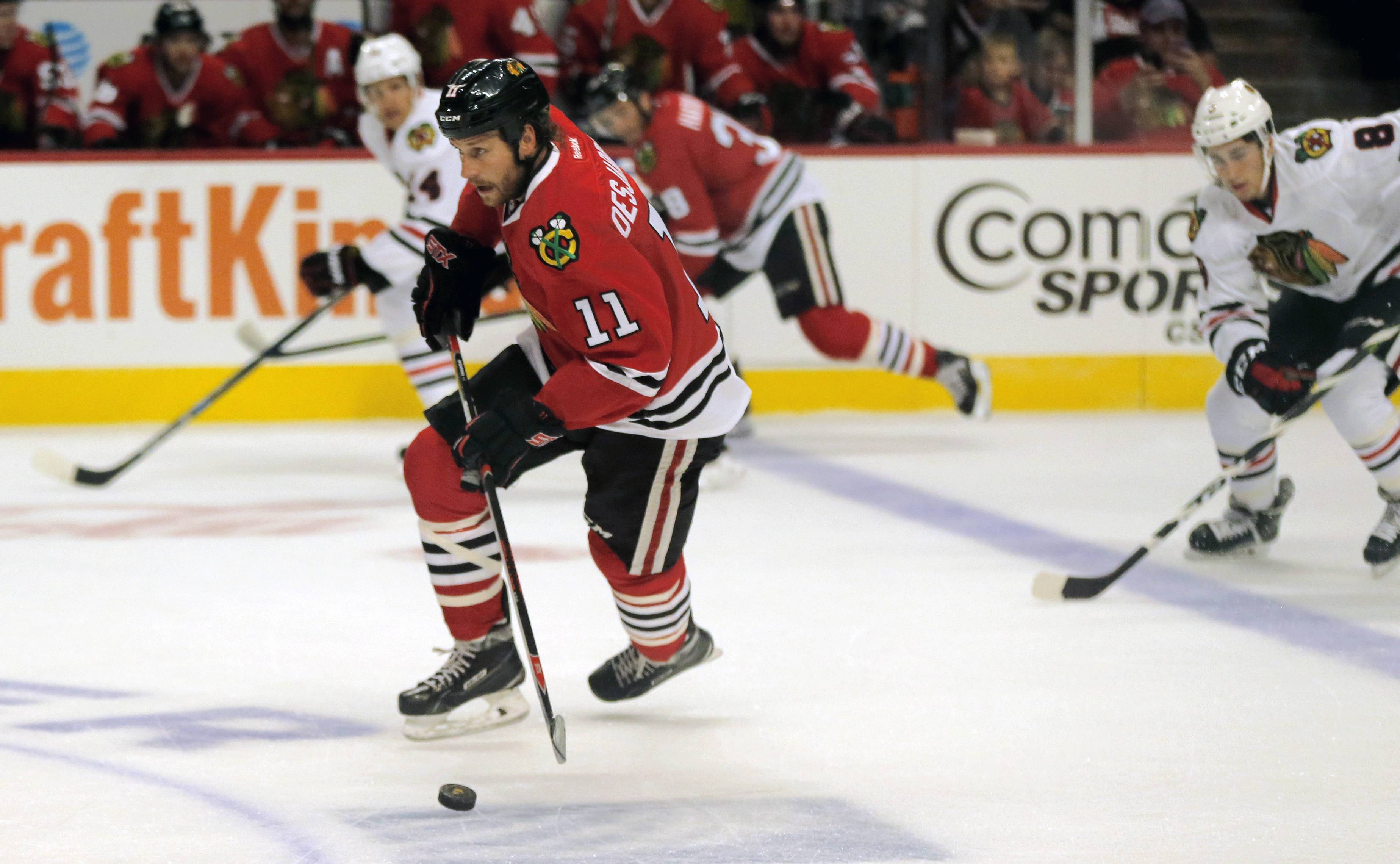 Chicago Blackhawks' Andrew Desjardins (11) controls the puck in the first period during the Chicago Blackhawks Training Camp Fest hockey scrimmage at the United Center Saturday, Sept. 24, 2016, in Chicago. (AP Photo/Tae-Gyun Kim)