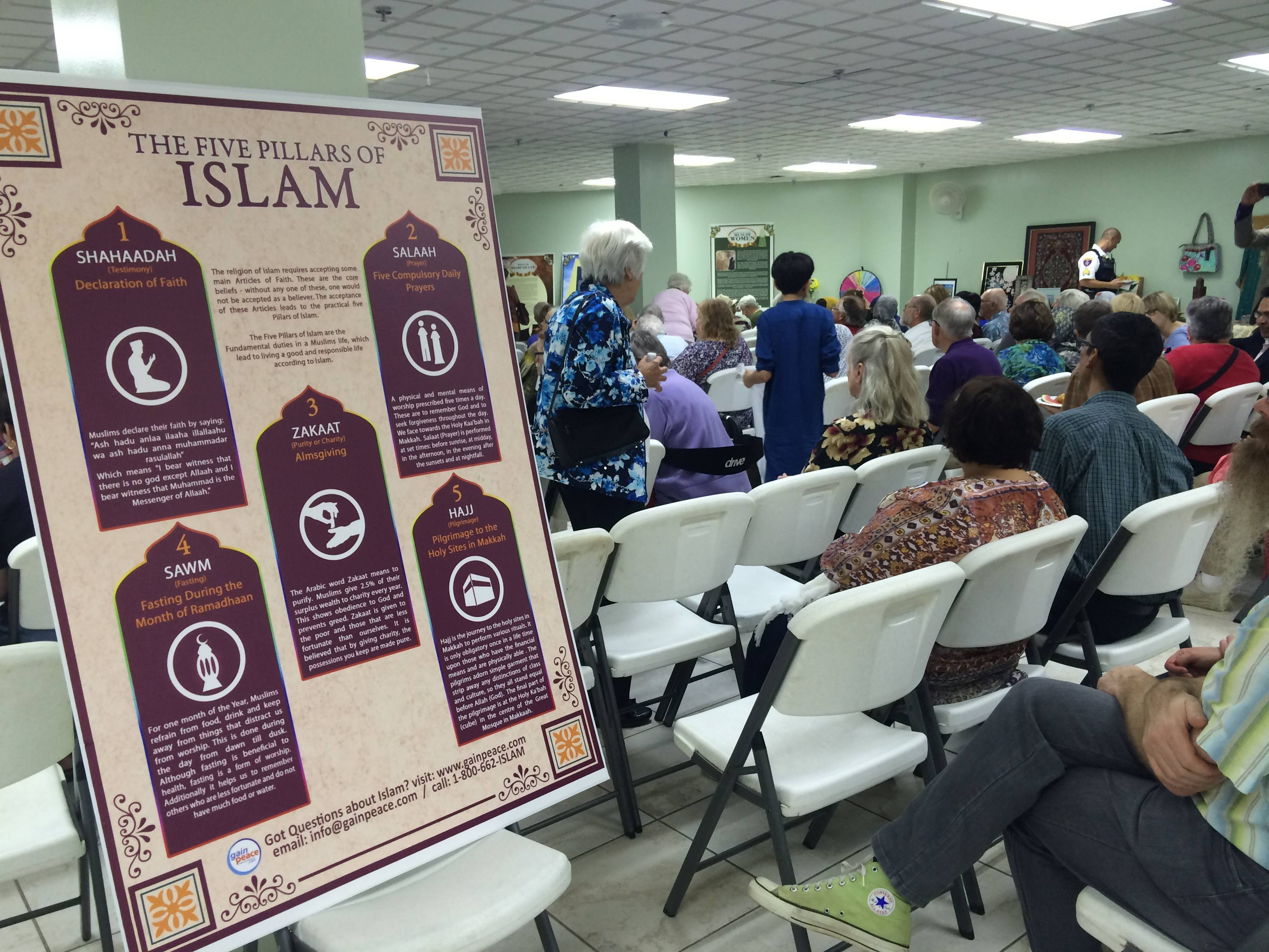 The open house at Islamic Foundation North in Libertyville included a presentation by Sabeel Ahmed, director of the Gain Peace project.