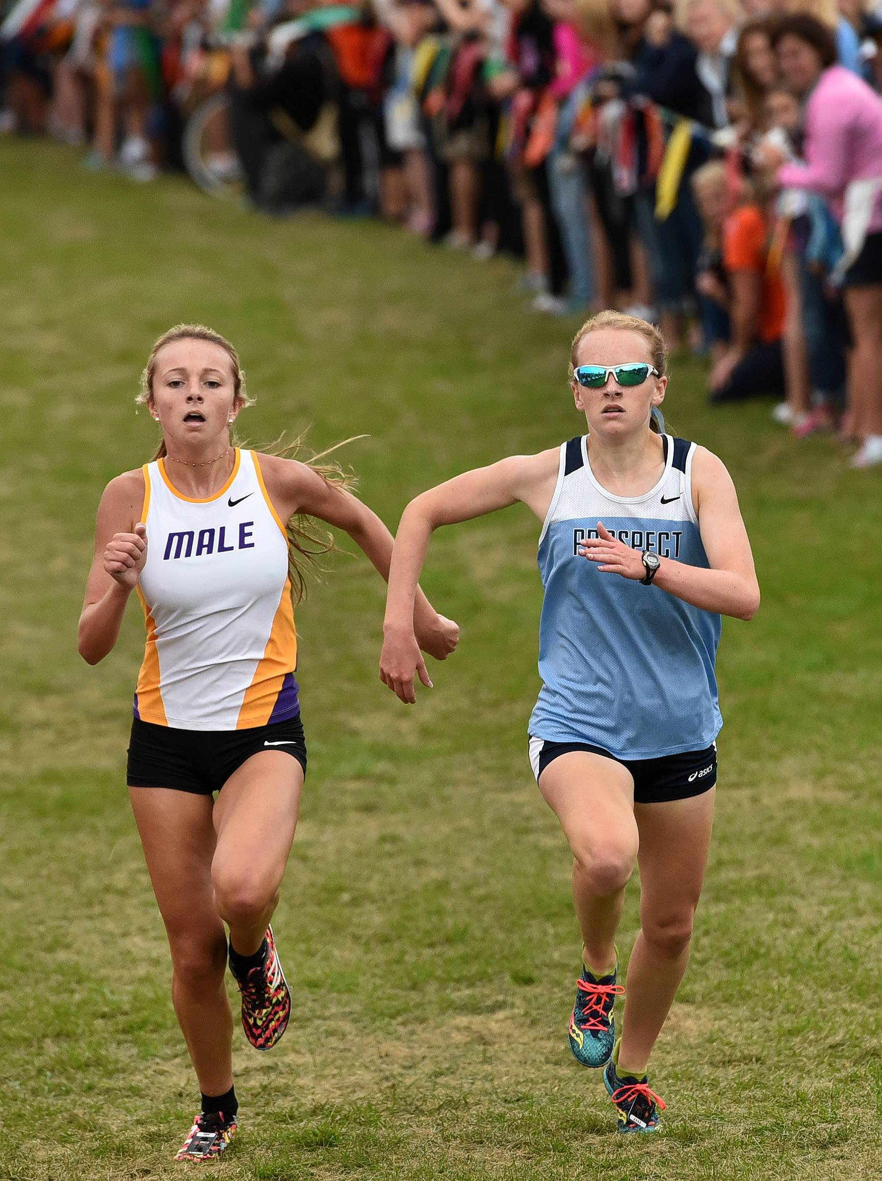 Brooke Wilson of Prospect, right, is stride for stride with Kaitlyn Lacy of Louisville Male High School down the stretch leading to the finish. Wilson finished second to Lacy in the Palatine Invitational at Deer Grove East Forest Preserve on Saturday.