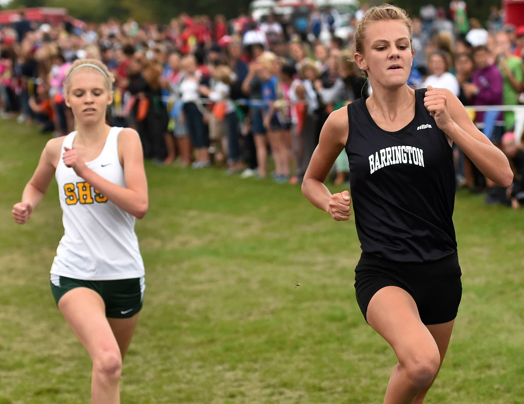 Jocelyn Long of Barrington, right, finishes third, edging out Isabelle Sparreo of Stevenson at the Palatine at Deer Grove East Forest Preserve on Saturday.
