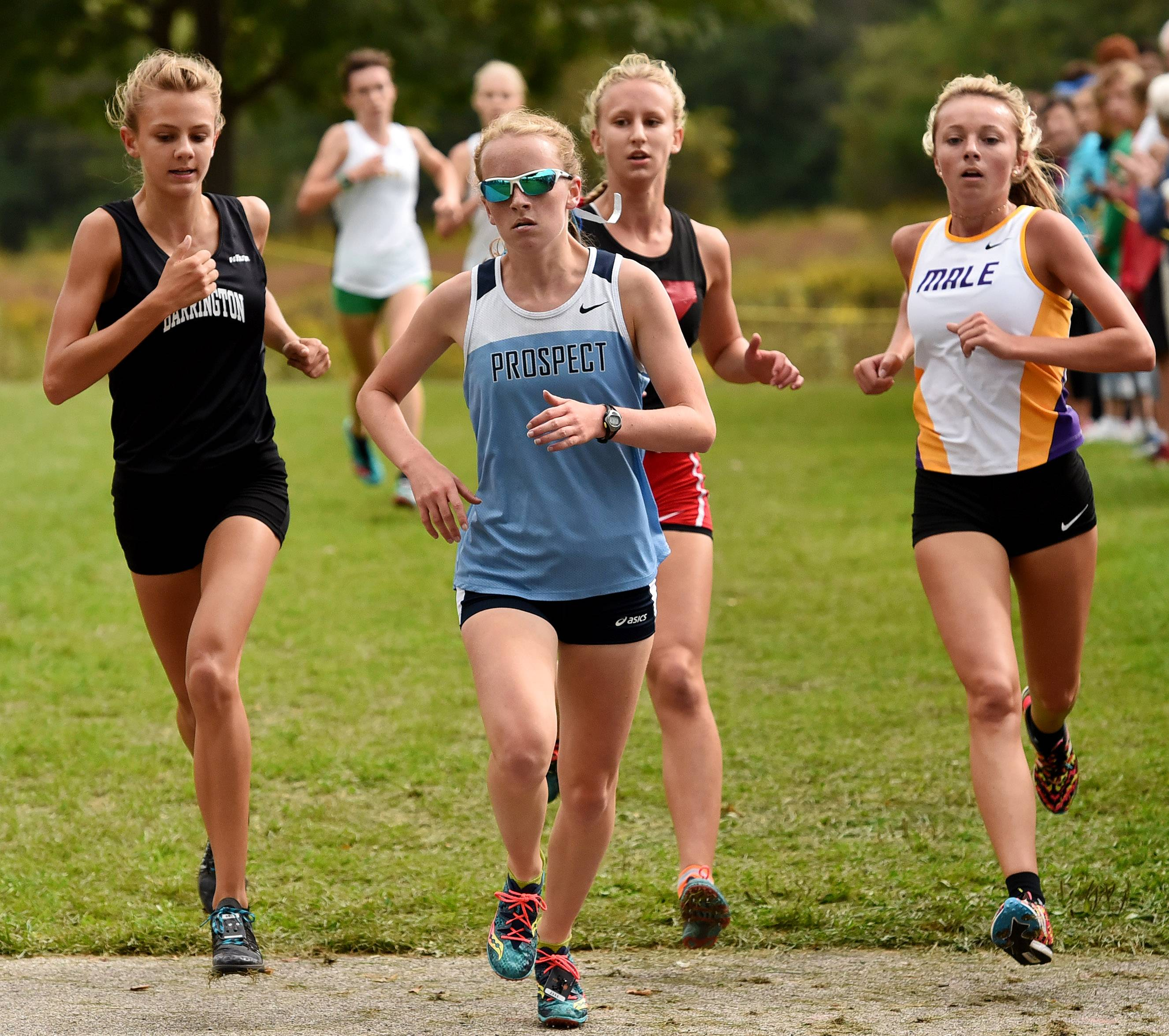 Brooke Wilson of Prospect leads the pack at the 2-mile mark in the Palatine Invitational at Deer Grove East Forest Preserve on Saturday.