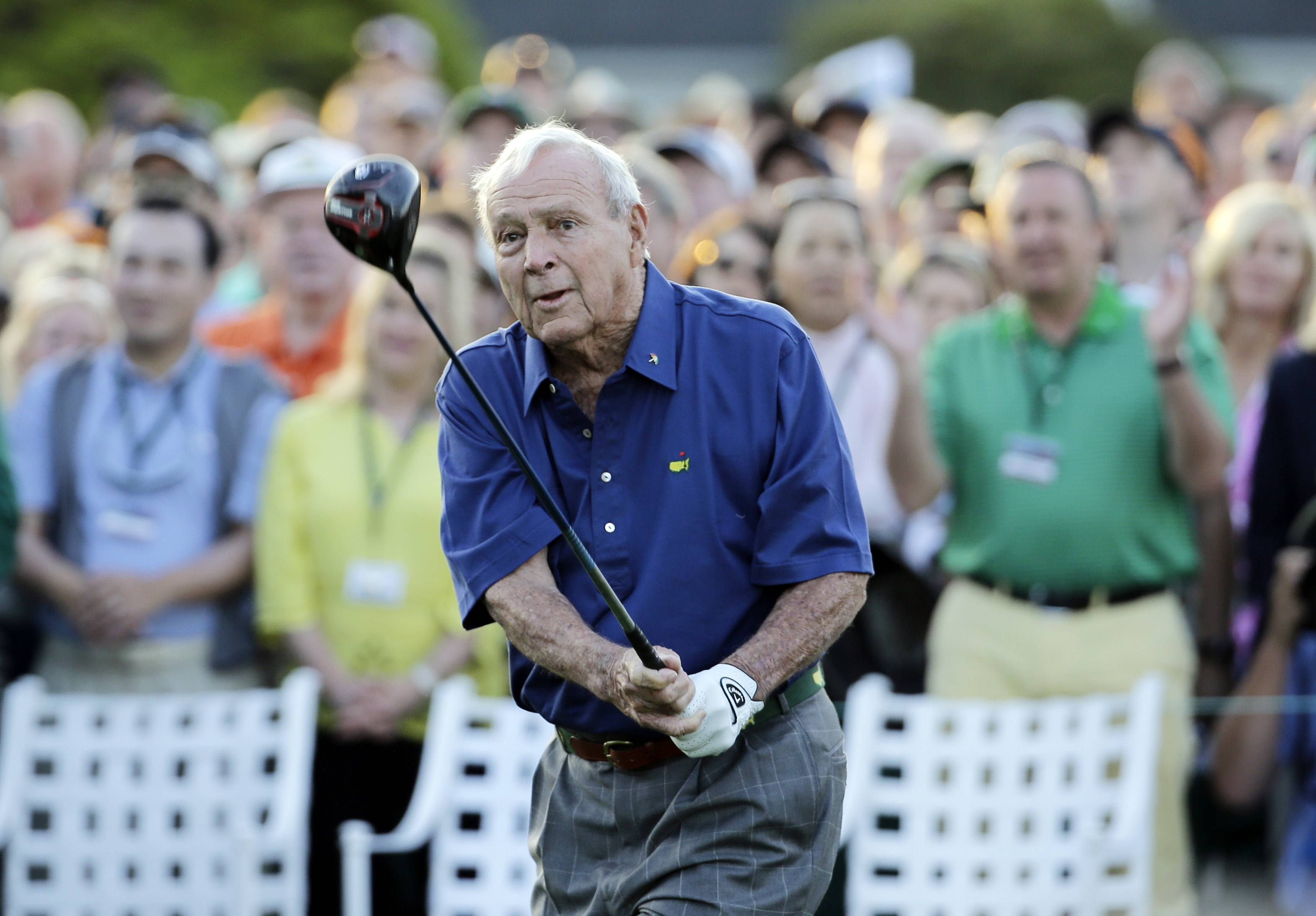 Arnold Palmer watches his tee shot for the honorary tee off before the first round of the Masters golf tournament Thursday, April 9, 2015, in Augusta, Ga.