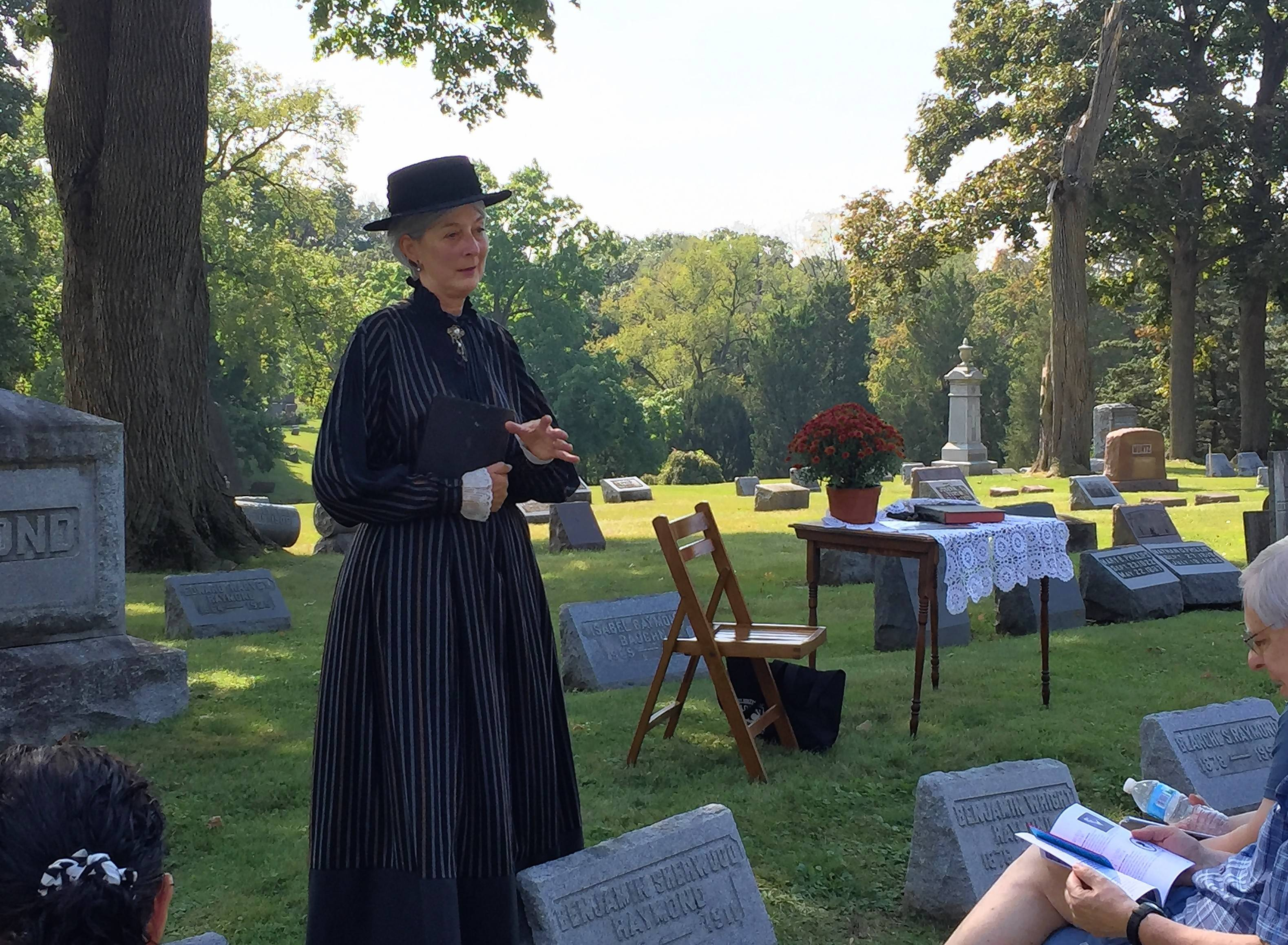 Elgin resident Linda Rock portrays Emily Lord, an abolitionist who started a girls' seminary in the 1800s, during the 29th annual Cemetery Walk at Bluff City Cemetery on Sunday.