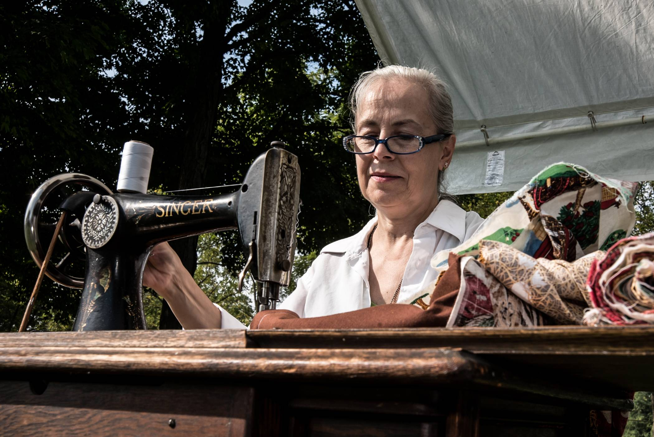 A 1905 Singer sewing machine works just fine Sunday for Trudi Handzel of Palatine during the 24th annual Farm Heritage Festival at the Lakewood Forest Preserve near Wauconda.