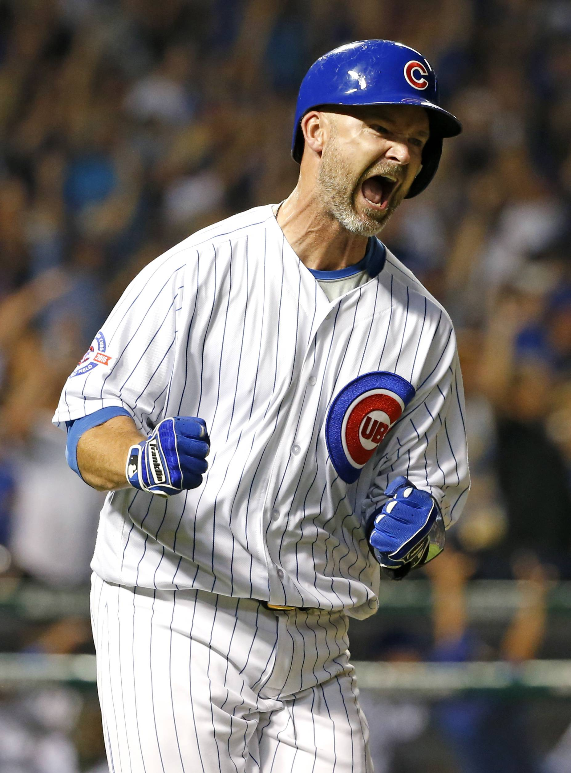 Chicago Cubs' David Ross reacts as he rounds the bases after hitting a solo home run during the fifth inning of a baseball game against the St. Louis Cardinals Sunday, Sept. 25, 2016, in Chicago. (AP Photo/Nam Y. Huh)