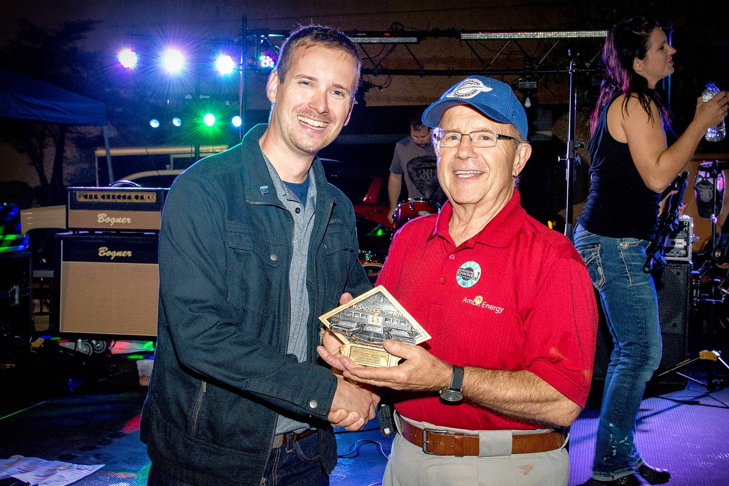 Classic Recollections columnist Matt Avery, left, makes Larry Leafblad of Crystal Lake the winner of his Daily Herald Cruise Night award.