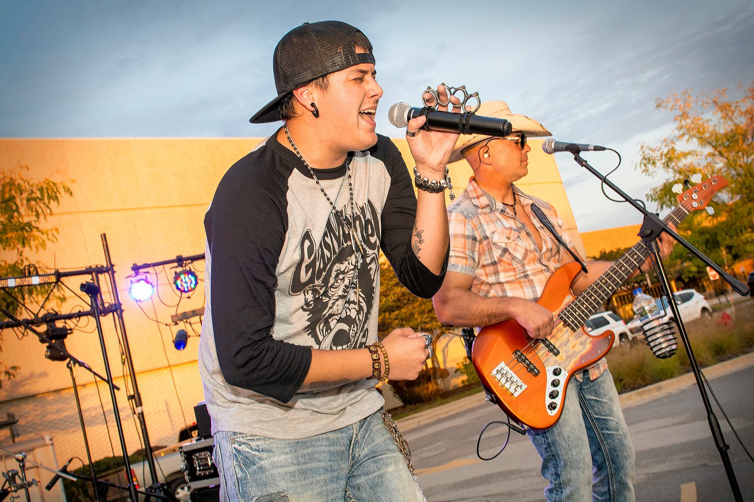 Kyle Boyer, left, and Mike Menola of the country band In the Stix perform at the final cruise night of the summer Wednesday at Stratford Square Mall in Bloomingdale.