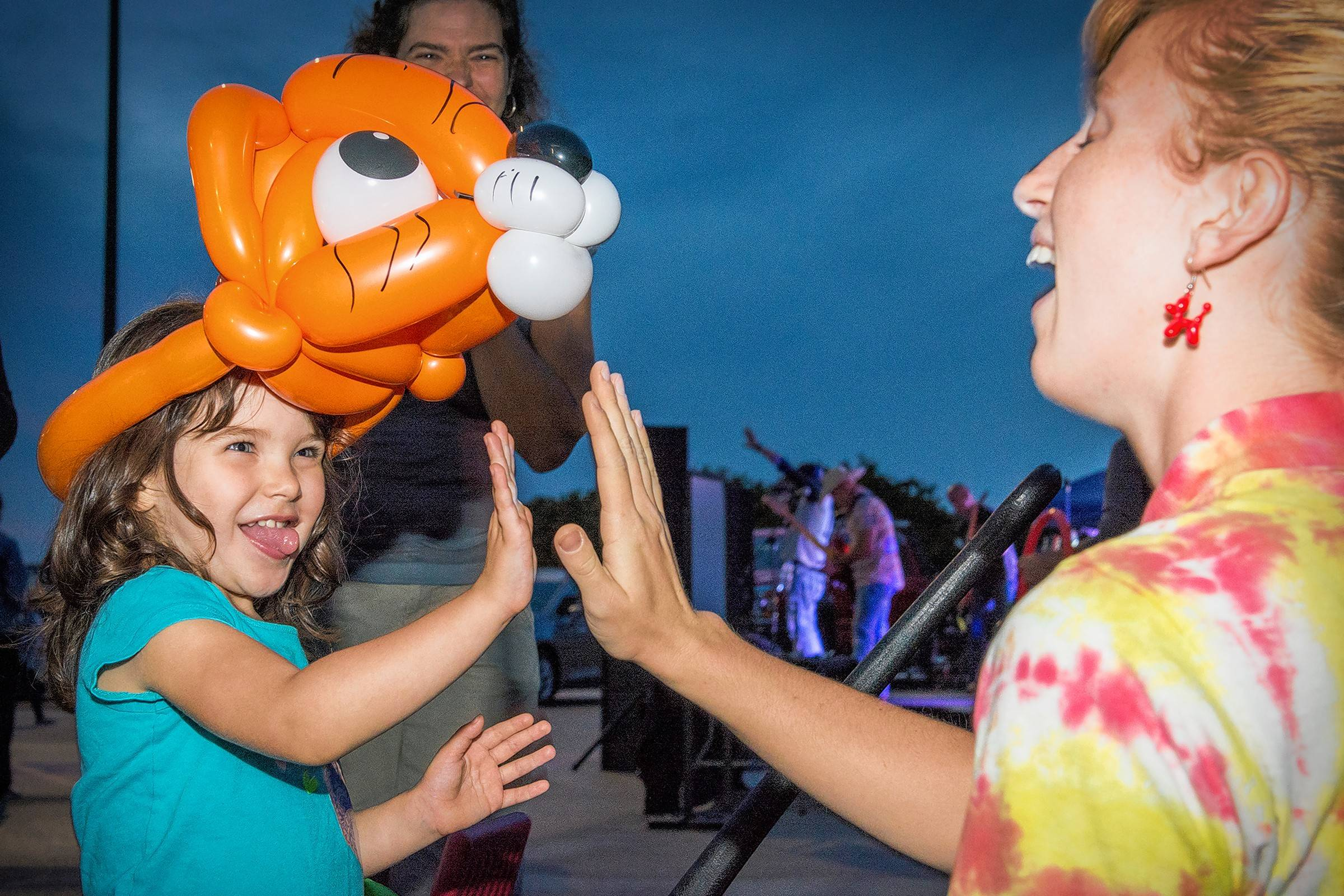 Annie McMillan, 3, of Hanover Park seems to approve of her tiger made by balloon artist Anna Freeman.