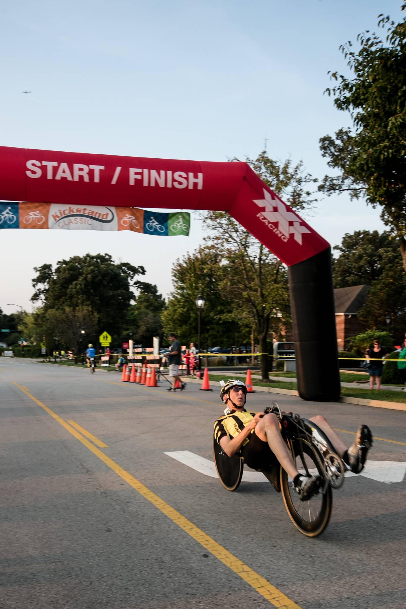 The first finisher in the Speedemon Class at the inaugural Bartlett Kickstand Classic crossed the finish line Sunday on recumbent bicycle.