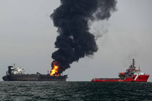 Firefighting boats works to extinguish a fire aboard the tanker Burgos about seven nautical miles off the coast of the port city of Boca del Rio, Mexico, Saturday, Sept. 24, 2016. The tanker was carrying about 168,000 barrels of gasoline and diesel fuel. Mexico's Navy rescued 31 crew members and no injuries were reported. There were no immediate reports of fuel spills and the cause of the fire was unknown. (AP Photo/Ilse Huesca)