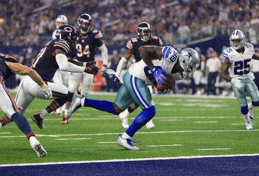 Dallas Cowboys wide receiver Dez Bryant (88) runs past Chicago Bears' Tracy Porter, left, into the end zone after catching a pass for a touchdown in the second half of an NFL football game, Sunday, Sept. 25, 2016, in Arlington, Texas. (AP Photo/Ron Jenkins)