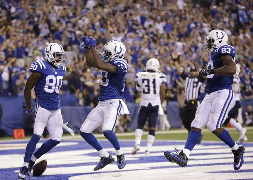 Indianapolis Colts' T.Y. Hilton (13) celebrates after a 63-yard touchdown reception during the second half of an NFL football game against the San Diego Chargers, Sunday, Sept. 25, 2016, in Indianapolis. (AP Photo/AJ Mast)