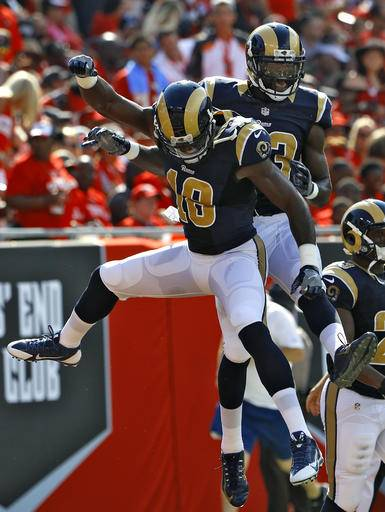 Los Angeles Rams wide receiver Brian Quick, right, celebrates with wide receiver Kenny Britt (18) after Quick caught a 44-yard touchdown pass during the first quarter of an NFL football game against the Tampa Bay Buccaneers Sunday, Sept. 25, 2016, in Tampa, Fla. (AP Photo/Scott Audette)