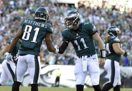 Philadelphia Eagles' Carson Wentz, center, celebrates with Jordan Matthews after Matthews scored a touchdown during the first half of an NFL football game against the Pittsburgh Steelers, Sunday, Sept. 25, 2016, in Philadelphia. (AP Photo/Michael Perez)