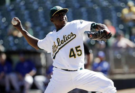 Oakland Athletics starting pitcher Jharel Cotton throws to the Texas Rangers during the first inning of a baseball game Sunday, Sept. 25, 2016, in Oakland, Calif. (AP Photo/Marcio Jose Sanchez)