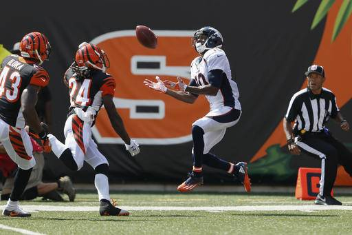 Denver Broncos wide receiver Emmanuel Sanders (10) catches a touchdown pass against Cincinnati Bengals cornerback Adam Jones (24) and free safety George Iloka (43) during the first half of an NFL football game, Sunday, Sept. 25, 2016, in Cincinnati. (AP Photo/Gary Landers)