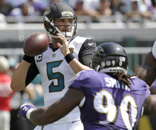 Jacksonville Jaguars quarterback Blake Bortles (5) looks for a receiver as he is pressured by Baltimore Ravens linebacker Za'Darius Smith (90) during the first half of an NFL football game in Jacksonville, Fla., Sunday, Sept. 25, 2016. (AP Photo/John Raoux)