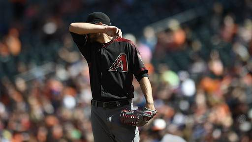 Arizona Diamondbacks starting pitcher Braden Shipley wipes his face after giving up a hit to the Baltimore Orioles in the first inning of a baseball game, Sunday, Sept.25, 2016, in Baltimore. (AP Photo/Gail Burton)