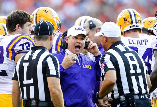 FILE - This Sept. 24, 2016 file photo shows LSU head coach Les Miles reacting to a call during the first half of an NCAA college football game against Auburn in Auburn, Ala. Two people familiar with the decision say LSU has fired Miles and offensive coordinator Cam Cameron and promoted defensive line coach Ed Orgeron to interim head coach. The person spoke to The Associated Press on Sunday, Sept. 25, 2016 on condition of anonymity because no announcement has been made. Miles firing comes one day after LSU lost 18-13 at Auburn. (AP Photo/Butch Dill, file)