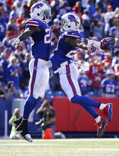 Buffalo Bills free safety Corey Graham, right, celebrates his interception with teammate Aaron Williams during the second half of an NFL football game on Sunday, Sept. 25, 2016, in Orchard Park, N.Y. (AP Photo/Bill Wippert)