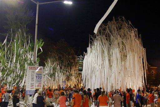 Fans celebrate at Toomer's Corner after Auburn defeated LSU 18-13 in an NCAA college football game Saturday, Sept. 24, 2016, in Auburn, Ala.(Todd J. Van Emst/Opelika-Auburn News via AP)
