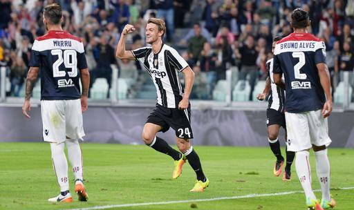 Juventus's Daniele Rugani celebrates after scoring a goal during the Serie A soccer match between Juventus and Cagliari at the Juventus Stadium in Turin, Italy, Wednesday, Sept. 21, 2016. (Alessandro Di Marco/ANSA via AP Photo)