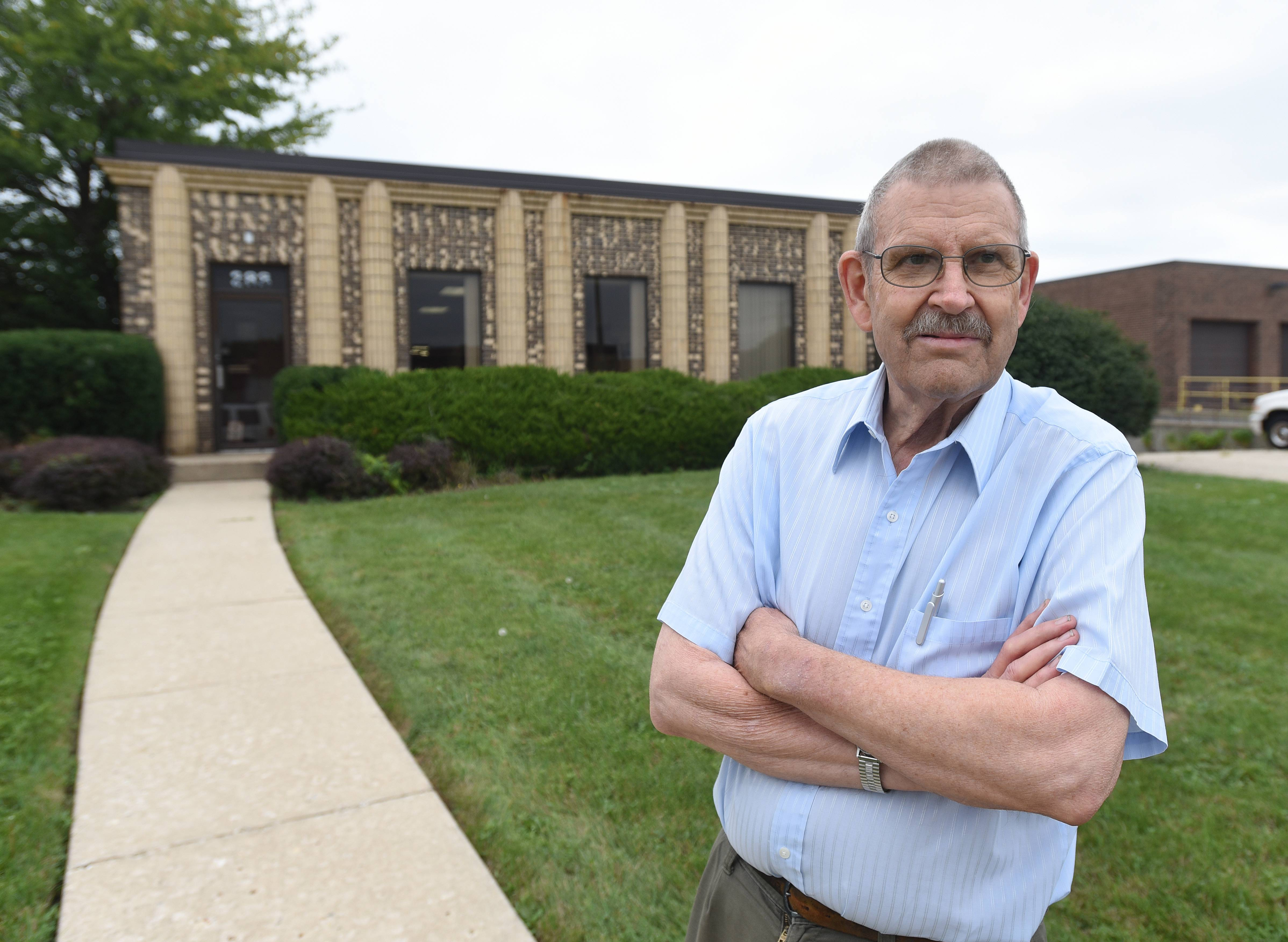 David Hale, founder and former owner of Scale-Tronix in Carol Stream, stands in front the factory that is expected to close in November under new owners.