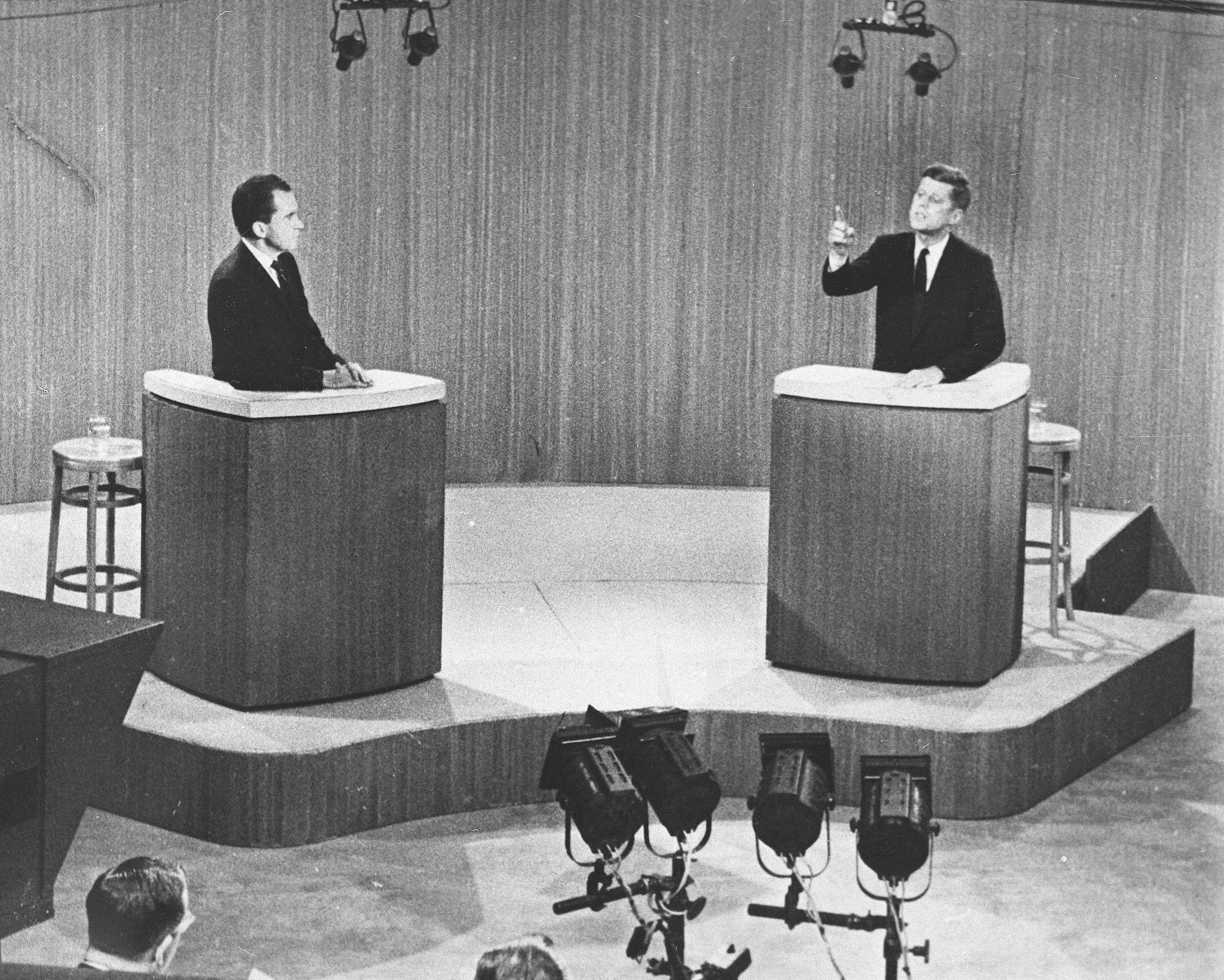 Republican Vice President Richard M. Nixon, listens as Sen. John F. Kennedy, the Democratic presidential nominee, makes a point during a live broadcast from a New York television studio of their fourth presidential debate on Oct. 21, 1960. The candidates' performance in this debate is often credited with helping lift Kennedy to victory in the general election.