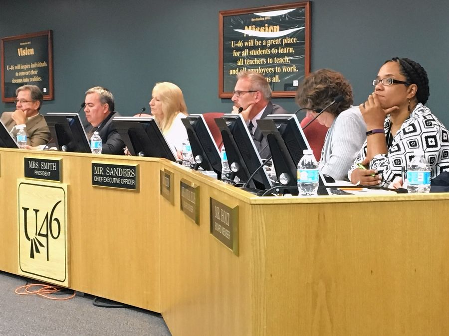 The Elgin Area School District U-46 school board and CEO Tony Sanders listen to public comments at Monday night's meeting.