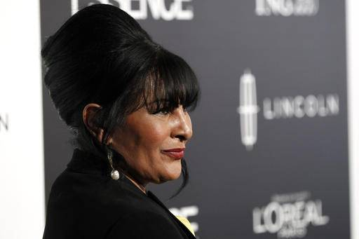 File-This Feb. 23, 2012, file photo shows honoree Pam Grier arriving at the 5th annual Essence Black Women in Hollywood Luncheon in Beverly Hills, Calif. Grier and opera soprano Jessye Norman are among the recipients of Harvard University's 2016 W.E.B. Du Bois medals honoring those who have made significant contributions to African and African American history and culture. Grier and Norman will be honored at the fourth annual Hutchins Center Honors on Oct. 6. (AP Photo/Matt Sayles, File)