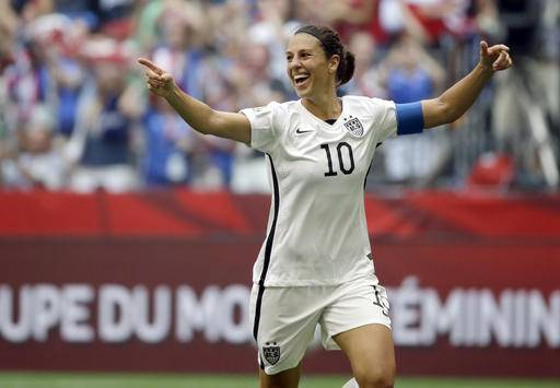 "FILE - In this July 5, 2015, file photo, Carli Lloyd of the U.S celebrates scoring her third goal against Japan during the first half of the FIFA Women's World Cup soccer championship in Vancouver, British Columbia, Canada. Lloyd reveals that she has been estranged from her family since 2008 in her new memoir, ""When Nobody Was Watching: My Hard-Fought Journey to the Top of the Soccer World"" which comes out on Monday, Sept. 26, 2016. (AP Photo/Elaine Thompson, File)"