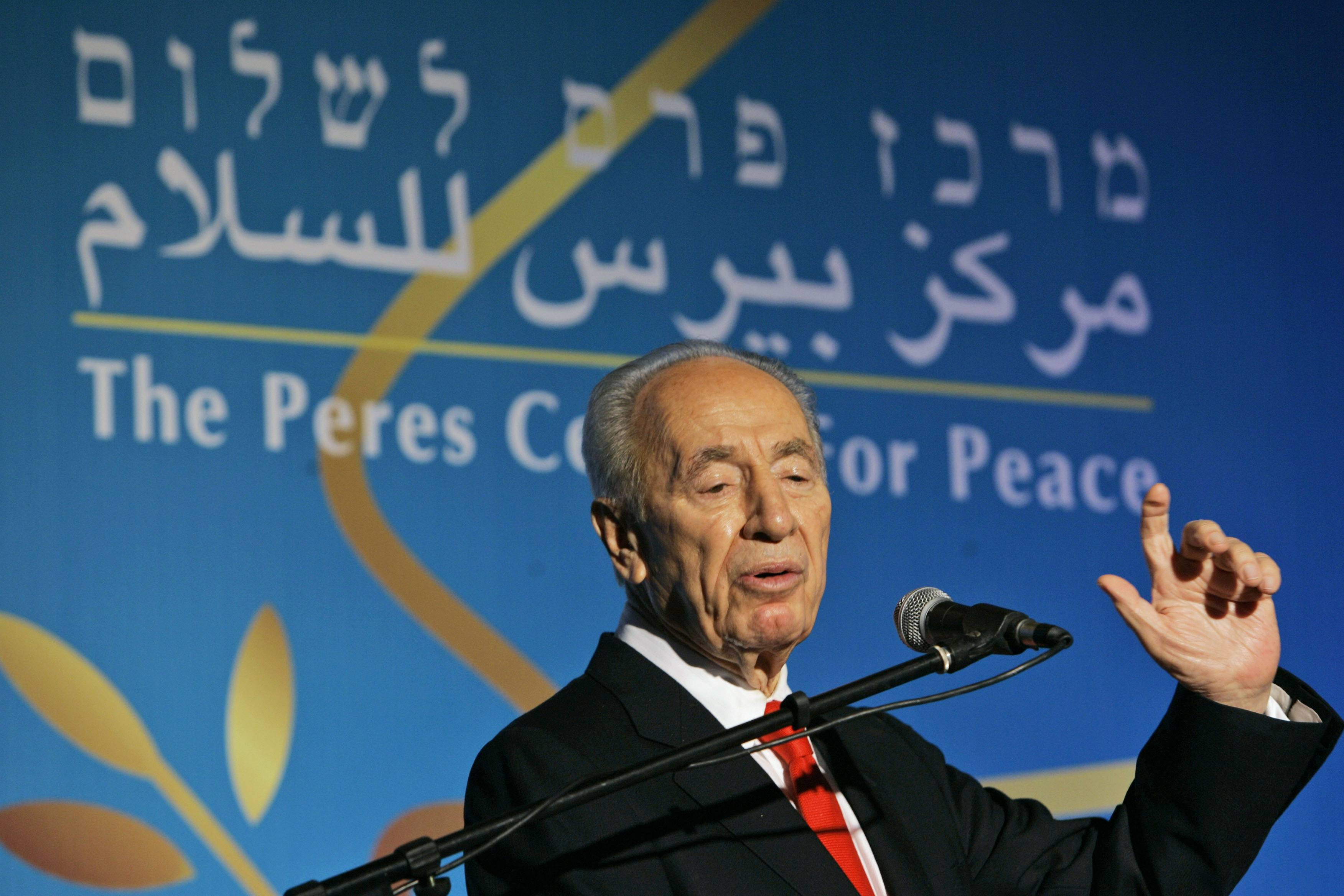 In this Oct. 28, 2008, file photo, Israeli President Shimon Peres speaks during the 10th anniversary celebration of the Peres Center for Peace in Tel Aviv, Israel.