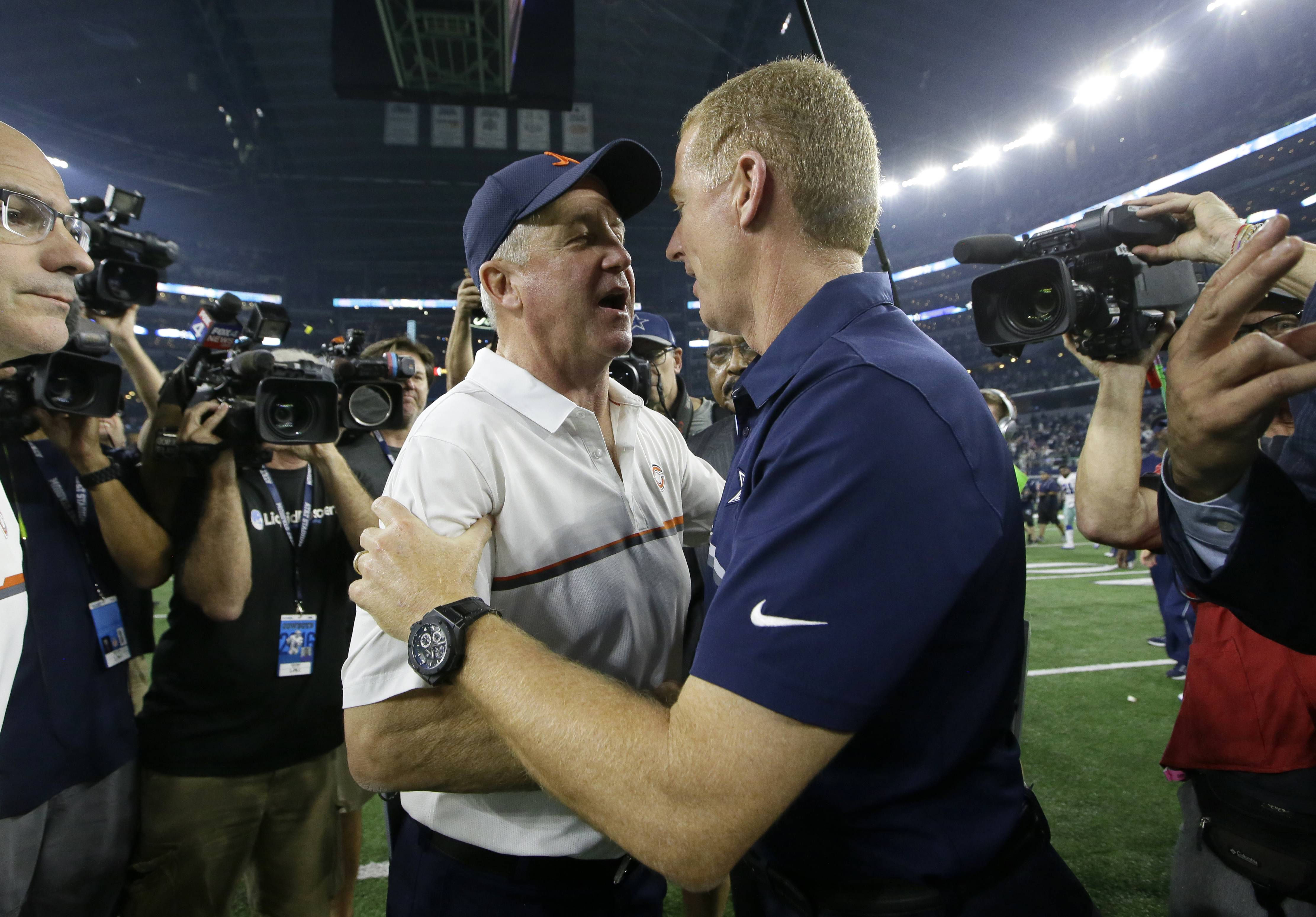 Chicago Bears head coach John Fox, left, and Dallas Cowboys head coach Jason Garrett, right, greet each other after their NFL football game, Sunday, Sept. 25, 2016, in Arlington, Texas. (AP Photo/LM Otero)