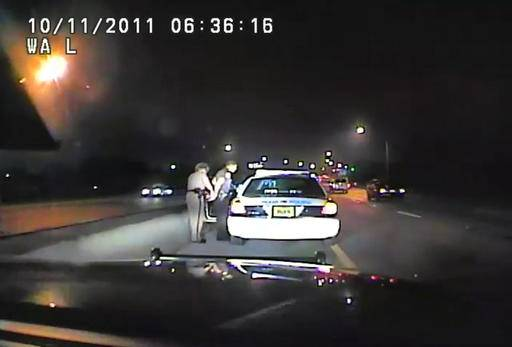 In this image made from an Oct. 11, 2011 video made available by the Florida Department of Highway Safety and Motor Vehicles, Florida Highway Patrol Officer Donna Watts arrests Miami Police Department Officer Fausto Lopez who was traveling at 120 miles per hour to an off-duty job, in Hollywood, Fla. After the incident, Watts says that she was harassed with prank calls, threatening posts on law enforcement message boards and unfamiliar cars that idled near her home. In lawsuits, she accused dozens of officers of obtaining information about her in the state's driver database. (Florida Department of Highway Safety and Motor Vehicles via AP)