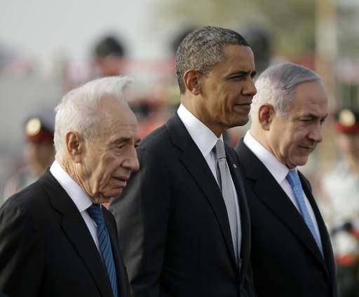 FILE - In this March 22, 2013, file photo, President Barack Obama walks on the tarmac with Israeli Prime Minister Benjamin Netanyahu, right, and Israeli President Shimon Peres, left, prior to his departure from Ben Gurion International Airport in Tel Aviv. Shimon Peres, a former Israeli president and prime minister, whose life story mirrored that of the Jewish state and who was celebrated around the world as a Nobel prize-winning visionary who pushed his country toward peace, has died, the Israeli news website YNet reported early Wednesday, Sept. 28, 2016. He was 93. (AP Photo/Pablo Martinez Monsivais, File)