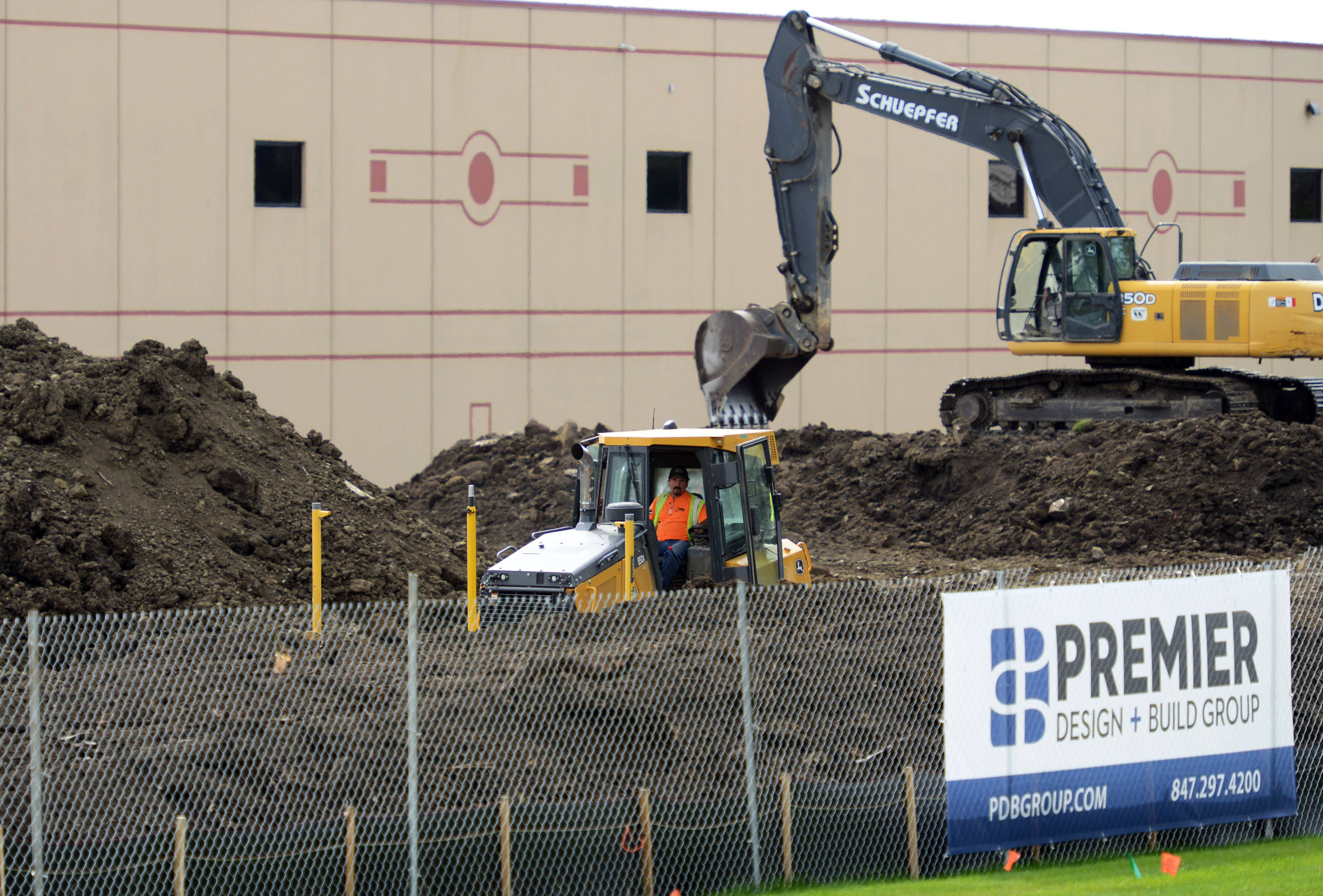 Paul Valade/pvalade@dailyherald.com Construction crews working at Echo Inc., the maker of high-end gas powered outdoor power equipment, where and expansion is in progress at the Lake Zurich company.