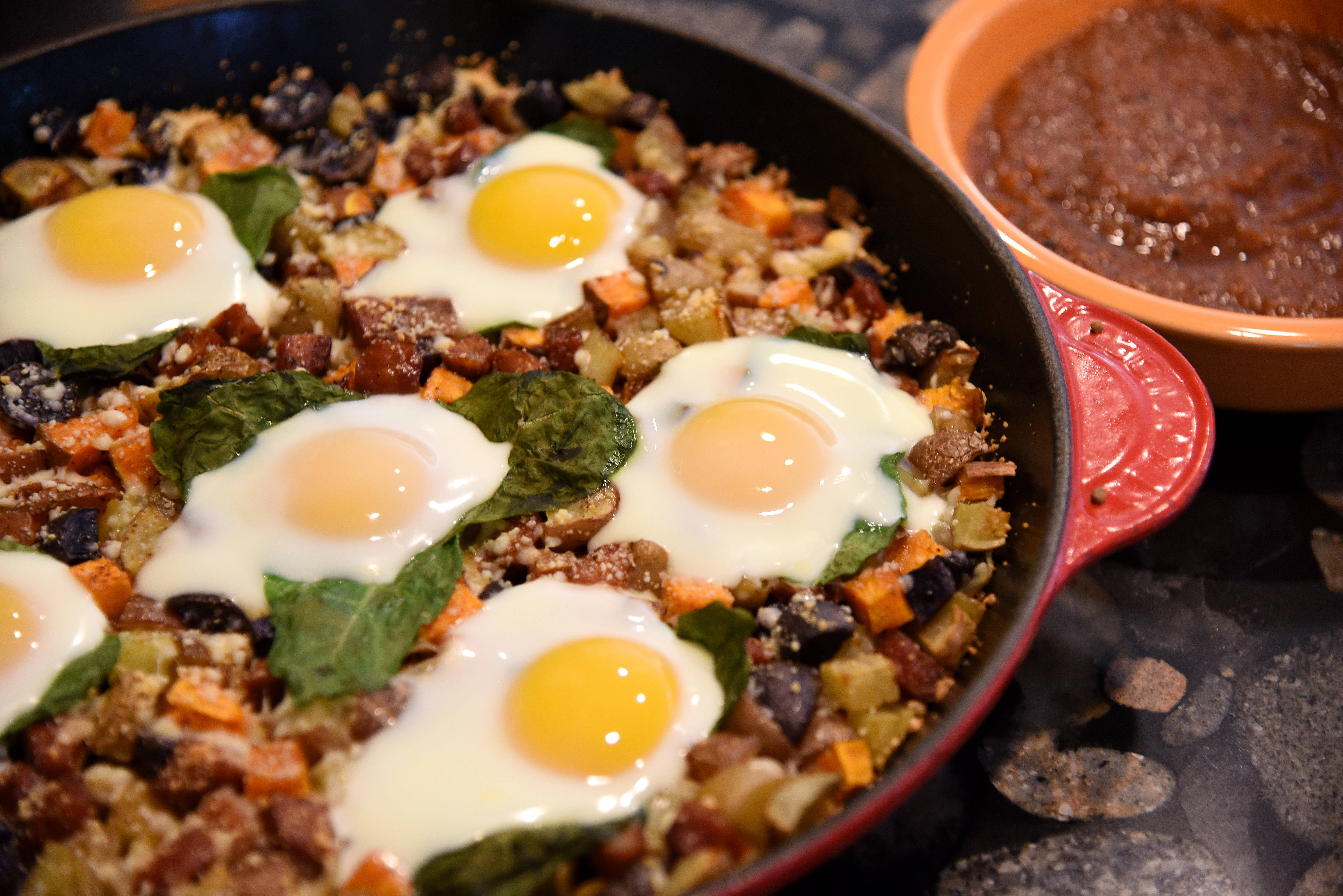 Sylvia Schafer of Cary made a dish using four different types of potatoes, andouille sausage, spinach and eggs with a hot salsa for the Cook of the Week Challenge judges.