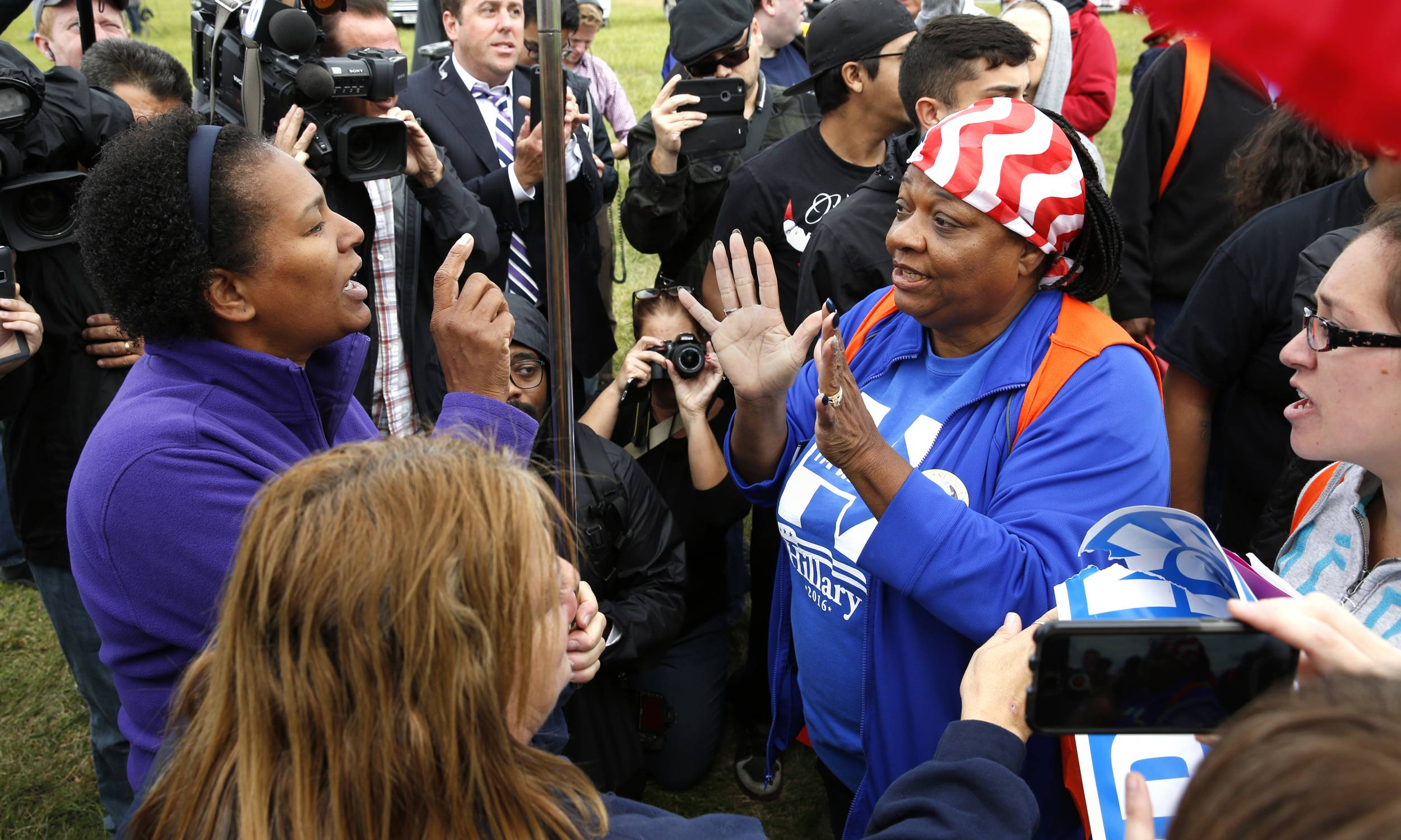 Trump supporter Stephanie Trussell of Lisle, left, debates with Clinton supporter Ruby Lofton of Bolingbrook outside the Bolingbrook Golf Club during a fundraiser Wednesday for GOP presidential nominee Donald Trump.