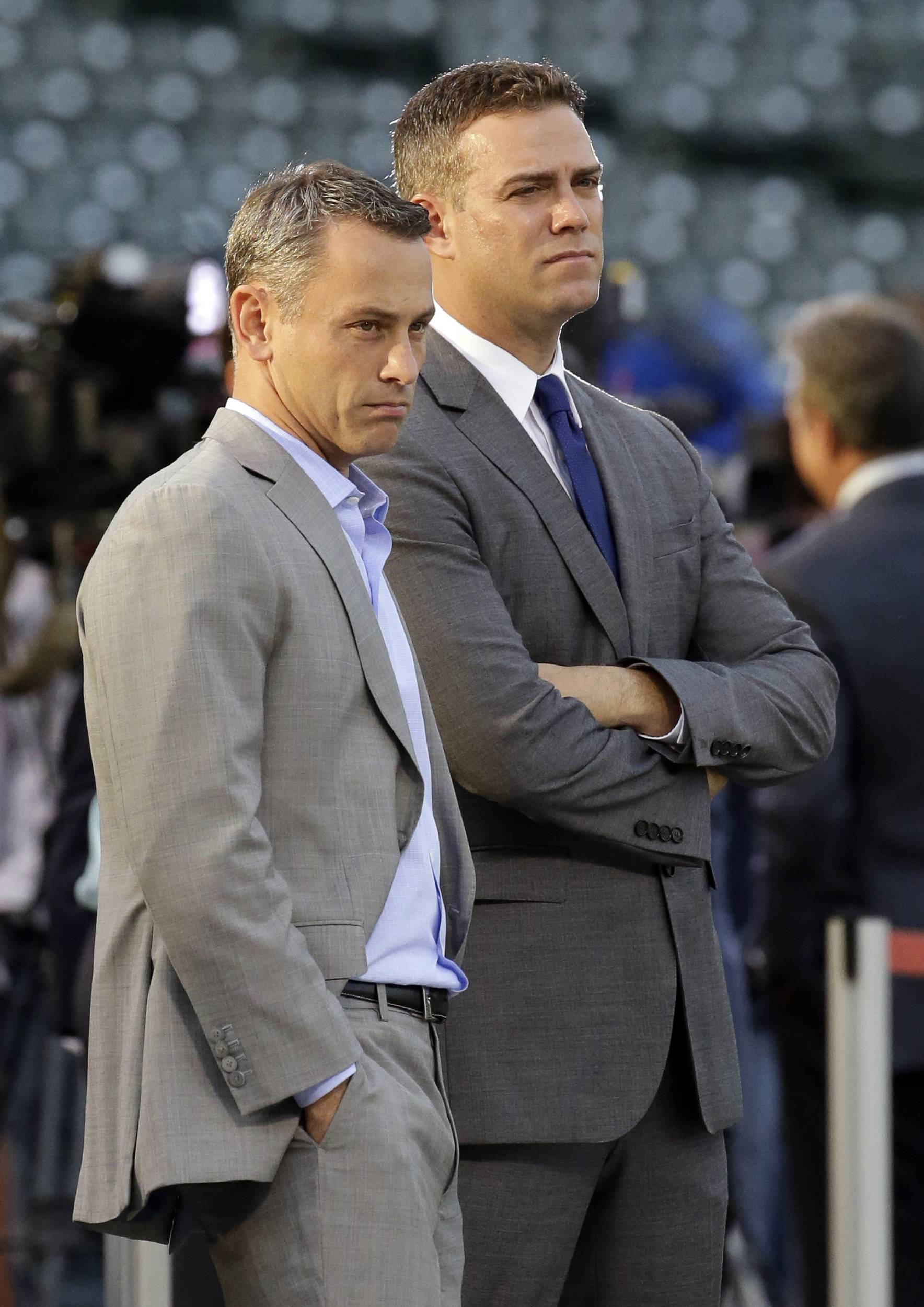 Chicago Cubs president of baseball operations Theo Epstein, right, has agreed to a five-year contract with the team. At left is general manager Jed Hoyer.