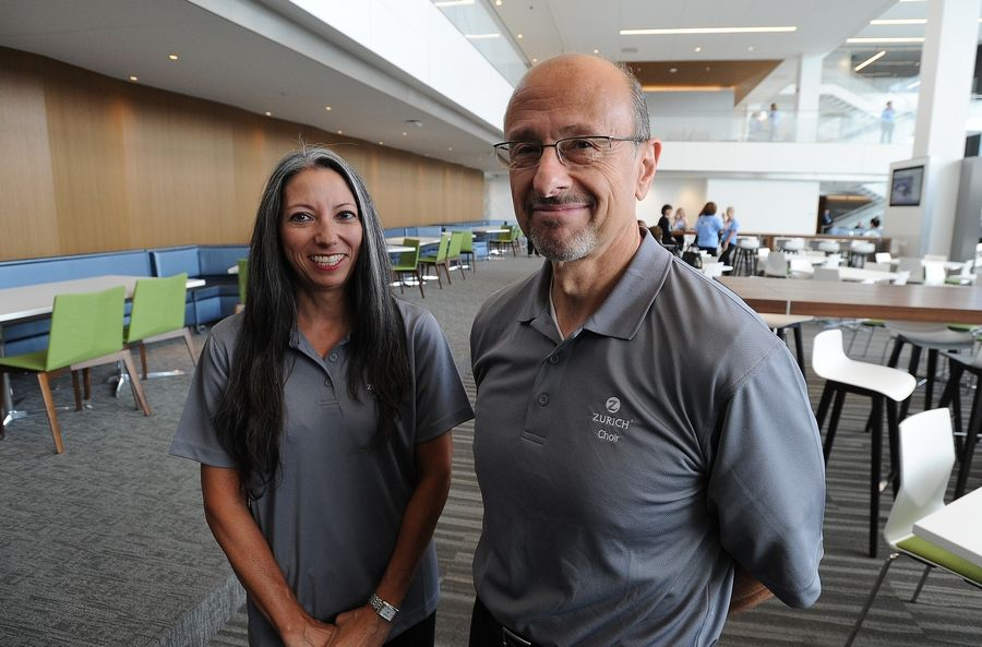 Zurich North America employees Donna Hachiya of Chicago and Bill Floriano of Park Ridge discuss their reaction Wednesday to getting their first look at the company's new headquarters in Schaumburg.