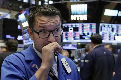 FILE - In this Monday, Sept. 26, 2016, file photo, trader Leon Montana works on the floor of the New York Stock Exchange. U.S. stock markets opened slightly higher Wednesday, Sept. 28, 2016, as energy companies are rising with the price of oil. (AP Photo/Richard Drew, File)