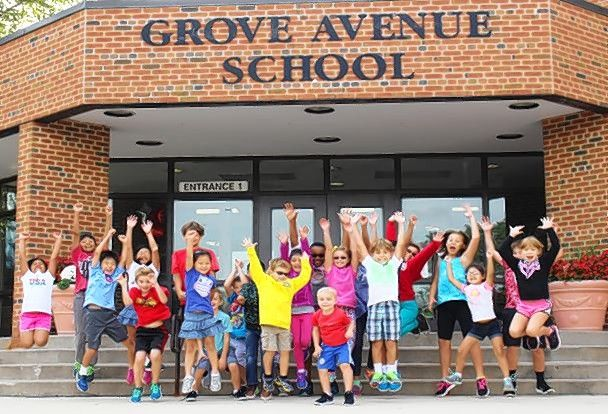 Students celebrate outside Grove Avenue Elementary School in Barrington after learning Wednesday the school had won a Blue Ribbon award.
