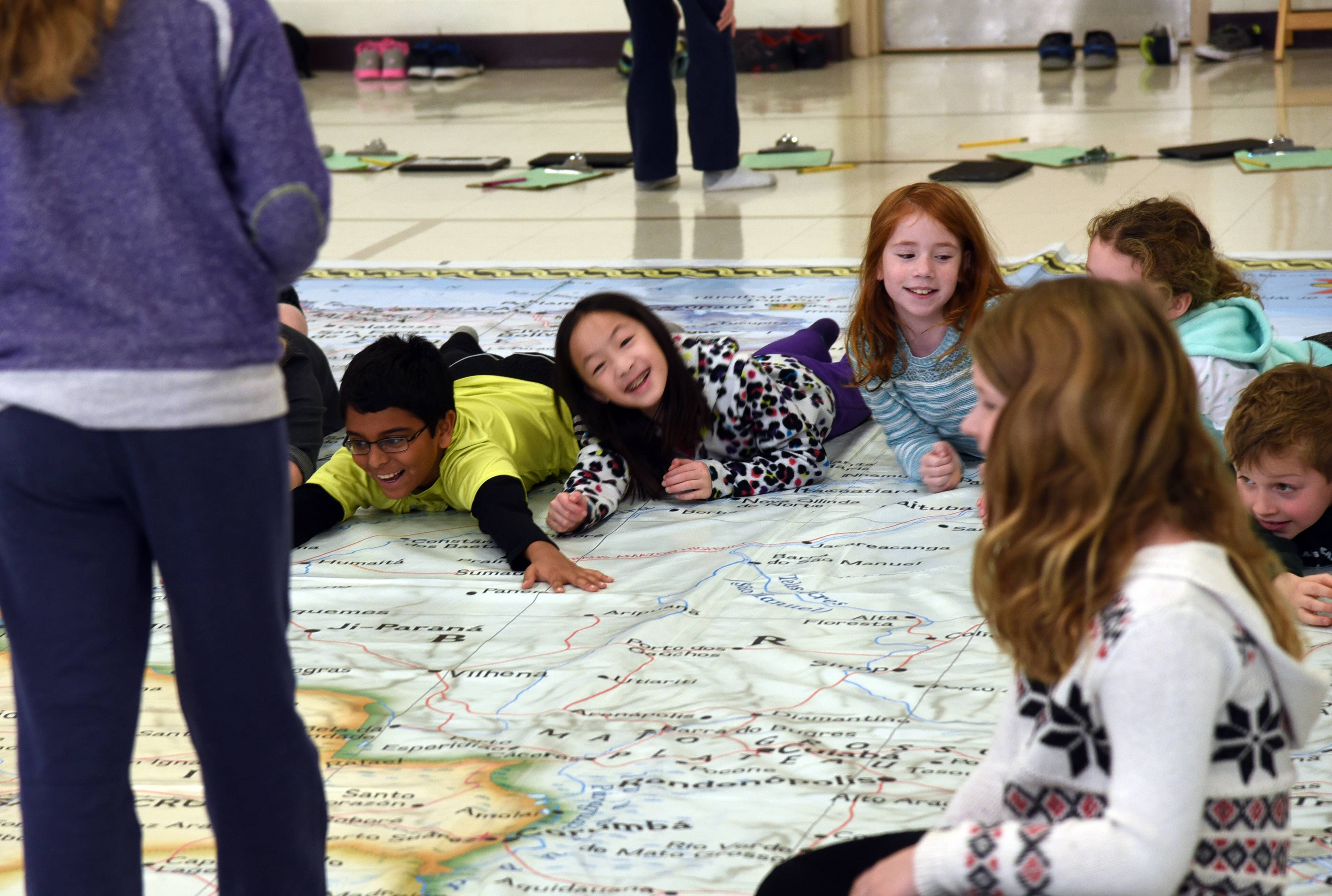 Half Day School in Lincolnshire, which serves grades three and four, on Wednesday was named a National Blue Ribbon Schools winner. Earlier this year, Half Day students pose for a photo while working with the National Geographic Society's giant map of South America.