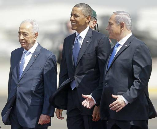 FILE - In this March 20, 2013, file photo, President Barack Obama is greeted by Israeli President Shimon Peres, left, and Israeli Prime Minister Benjamin Netanyahu upon his arrival ceremony at Ben Gurion International Airport in Tel Aviv, Israel. Shimon Peres, a former Israeli president and prime minister, whose life story mirrored that of the Jewish state and who was celebrated around the world as a Nobel prize-winning visionary who pushed his country toward peace, has died, the Israeli news website YNet reported early Wednesday, Sept. 28, 2016. He was 93. (AP Photo/Pablo Martinez Monsivais, File)